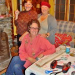 Diane Cushman, Catherine Kenyon, and Lillian Kennedy making bottle cap earrings
