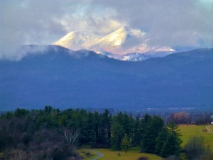 sunlight on Adirondack mountains view from Waltham Vermont